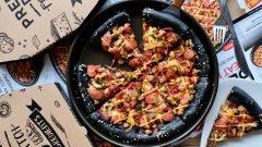 Ilustrasi black pizza meat monsta